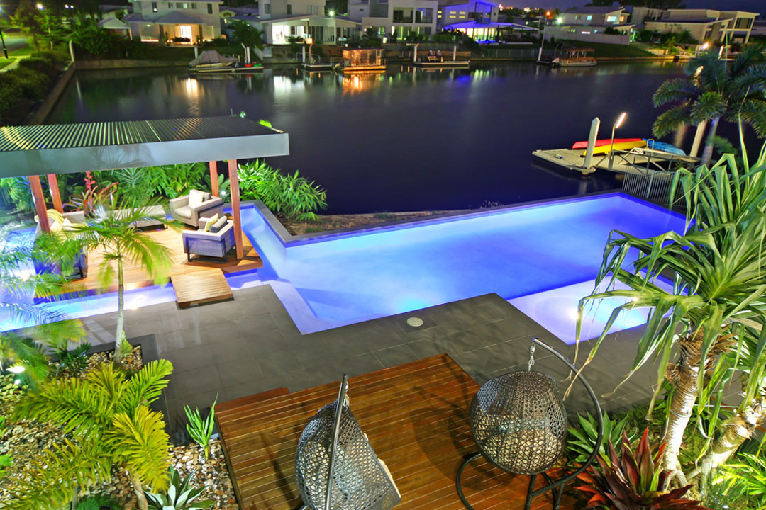 Queensland Pool + Outdoor Design Ecozen Pools + Landscapes nighttime pool and deck
